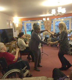 Orchestra of the Swan bassoonist Maria Mealey enjoying an impromptu dance session during a session at Barchester Edgbaston Beaumont, December 2016